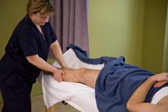 An MH Vicars RMT student massaging a patient's leg.