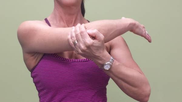Denise demonstrating a shoulder range of motion technique.