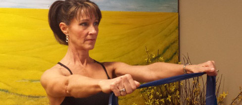 Denise demonstrating Resisted Shoulder Abduction, picture one.