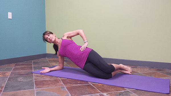 Denise showing a modified side plank for beginners
