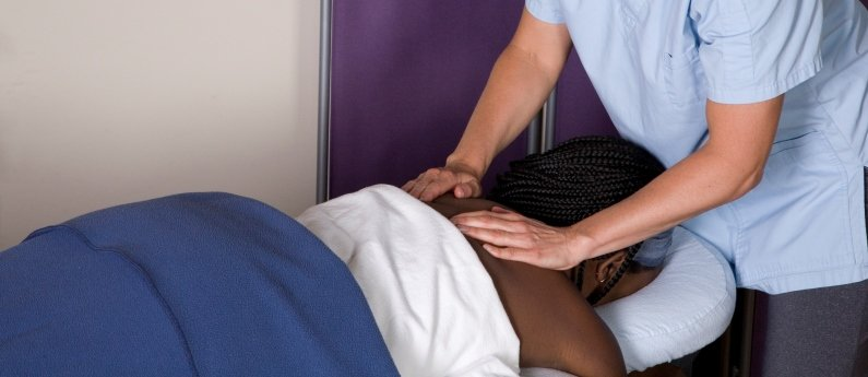 MH Vicars student giving a massage to a client. Looking for an RMT school? Come to MH Vicars.